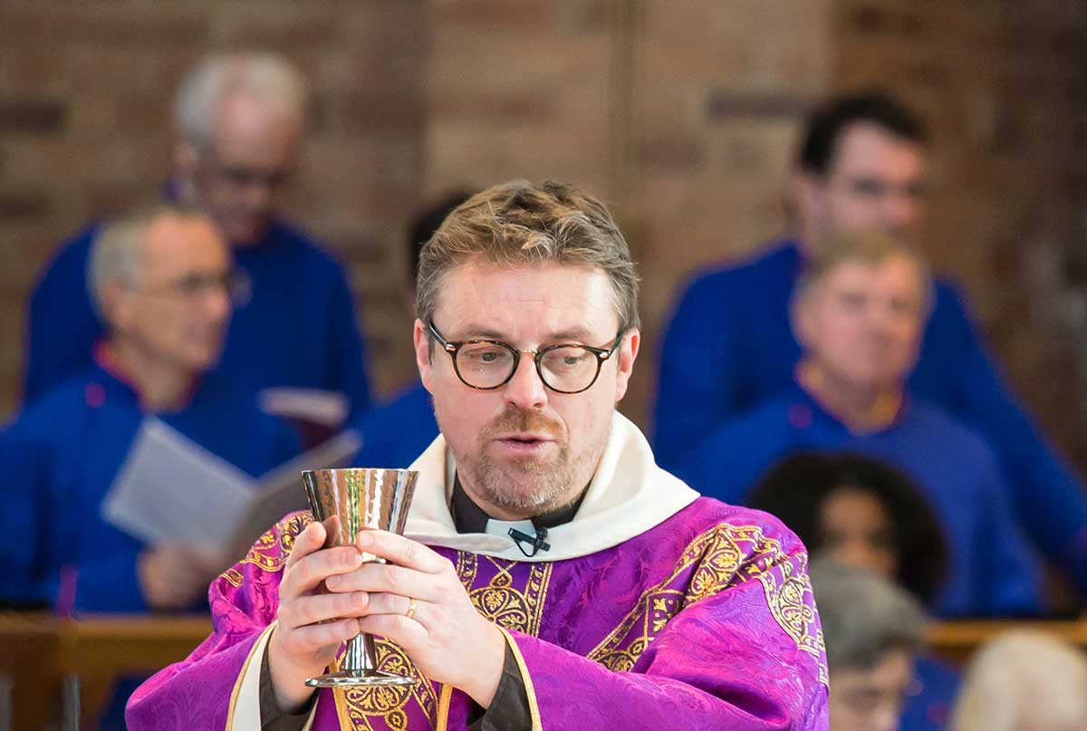 John presiding over Communion